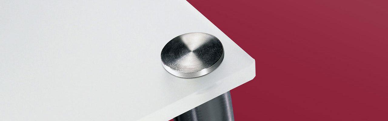 Avstandstykke i børstet stål